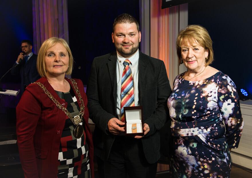 Winner Marius Marosan with an tArdmhéara Críona Ní Dhálaigh and Councillor Mary Freehill