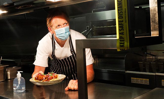 Chef in a face-mask.