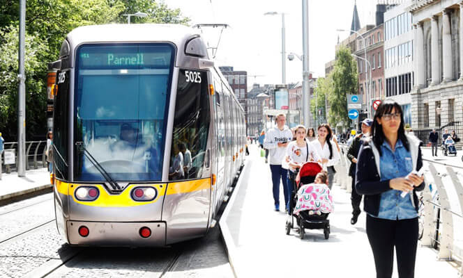 People getting off a Luas at Stephen's Green