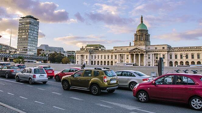 car traffic in the quays along dublin's river liffey