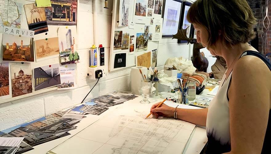 Elizabeth, drawing at her desk