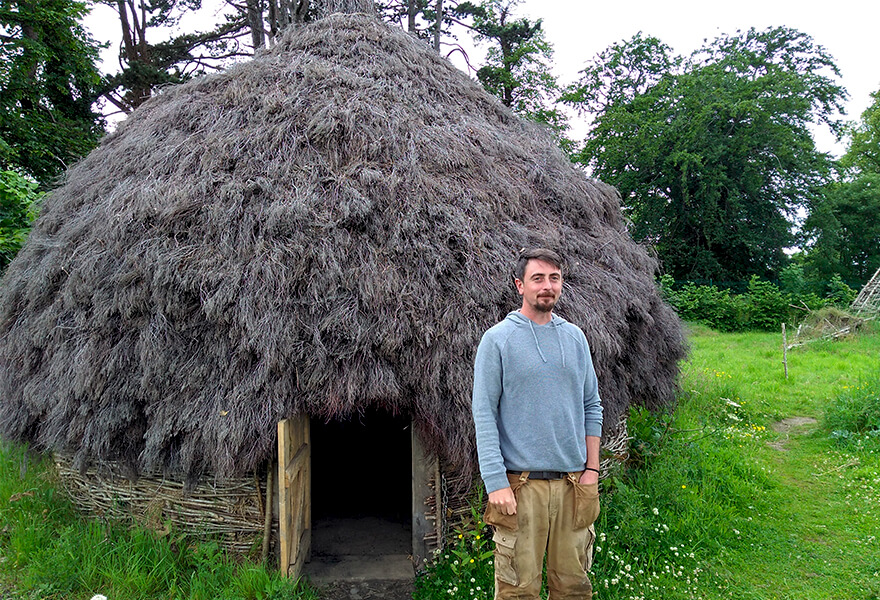 Experiential learning: PhD student Brendan O'Neill outside the roundhouse he constructed.