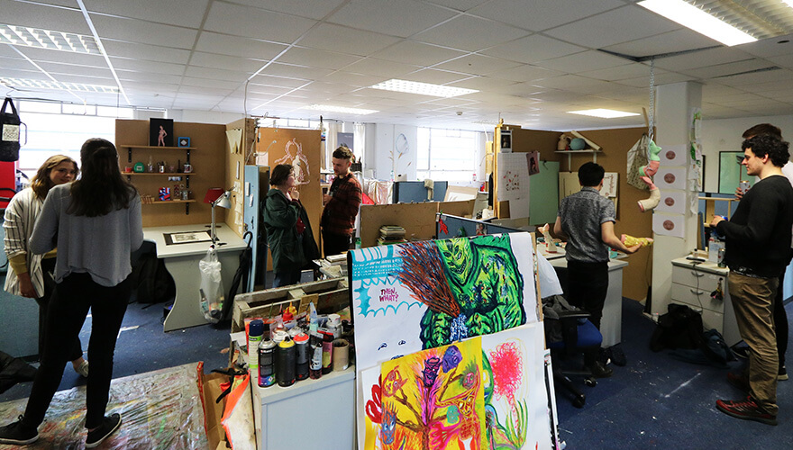 A thriving scene of people surrounded by vibrant artistic images