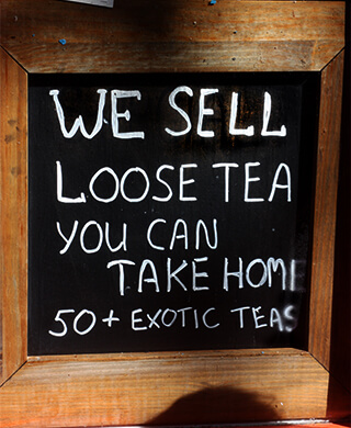 Chalkboard reads: We sell loose tea you can take home. 50+ exotic teas