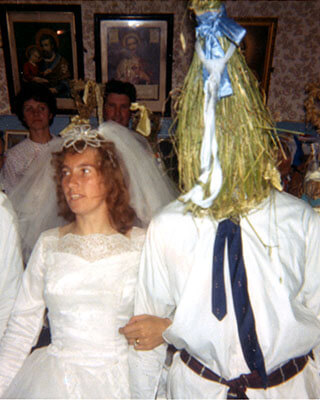 A bride with a 'Straw Boy' - Image courtesy of the National Folklore Collection.