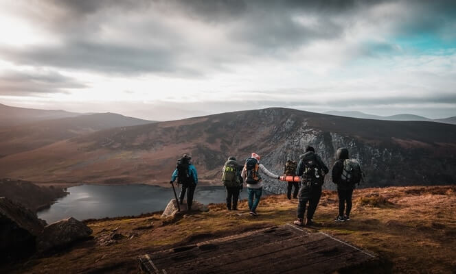 group of people hiking around lough tay